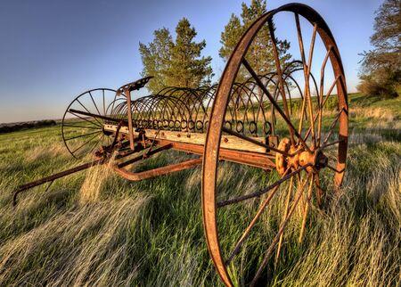 antique: Antique Farm Equipment sunset Saskatchewan Canada
