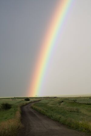 Storm Clouds Saskatchewan rainbow in prairie Canada Stock Photo - 16226481
