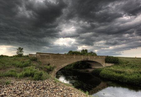 Storm Clouds Saskatchewan and old stone bridge Stock Photo - 16227969