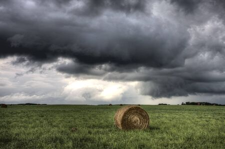 Storm Clouds Saskatchewan hay bales in Canada Stock Photo - 16230901