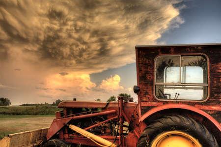 Storm Clouds Saskatchewan with antique vintage tractor Stock Photo - 16230886
