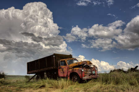 Storm Clouds Saskatchewan with antique abandoned truck Stock Photo - 16228690