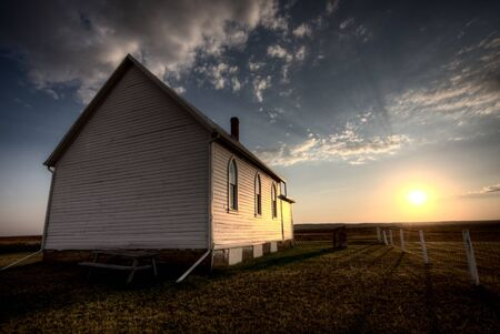 Storm Clouds Saskatchewan with country church at sunset Stock Photo - 16228630