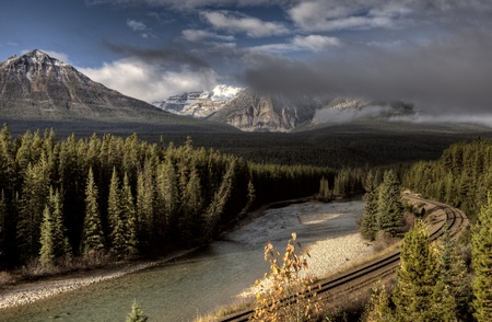 canada: Bow River and Train Tracks near Lake Louise Alberta Canada Stock Photo