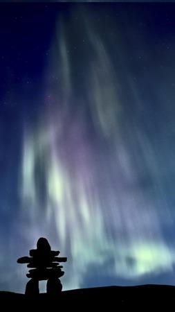 Inukshuk 및 오로라 서스 캐처 원 캐나다 다채로운