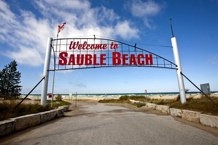 Sauble Beach Sign over roadway entrance red letters Stock Photo