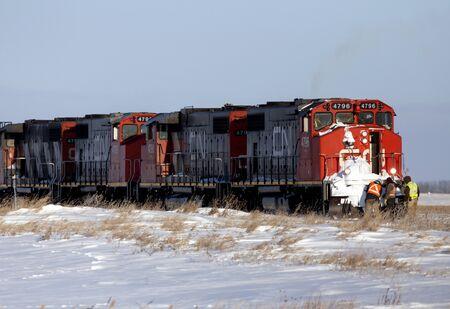 hauling: Men working on Train in Saskatchewan Canada in Winter