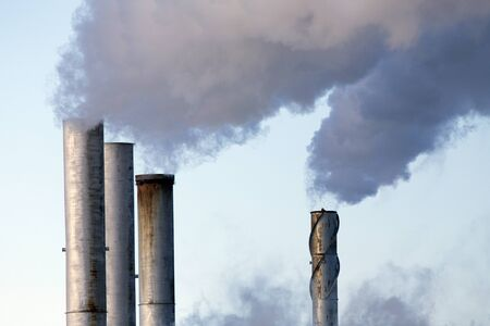Pollution discharge industry in Canada pipes spewing smoke Reklamní fotografie