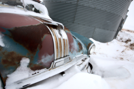 abandoned car: Antique abandoned car pontiac in winter canada