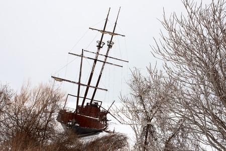 ship wreck: Old Abandoned rusty Sailboat on Lake Ontario Canada