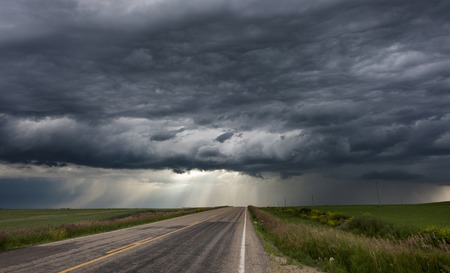 storms: Storm Clouds Prairie Sky Canada Ominous danger Stock Photo