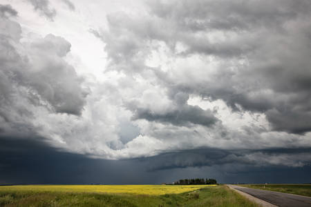 ominous: Storm Clouds Prairie Sky Canada Ominous danger Stock Photo