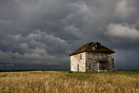storm clouds: Storm Clouds Prairie Sky Canada Ominous danger Stock Photo