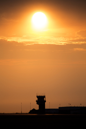 sillouette: Sunset Orange Sillouette and Flight Tower Canada Stock Photo
