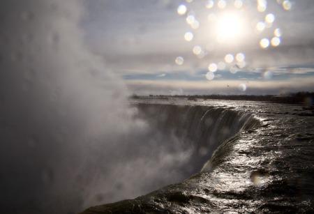 the edge of horseshoe falls: Niagara Falls Ontario sun shining close up Stock Photo