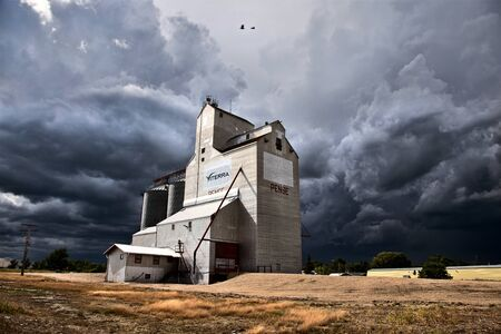 Storm Clouds Saskatchewan Grain Elevator in Canada Stock Photo