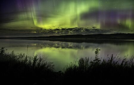 Northern Lights Aurora Borealis Saskatchewan reflection lake