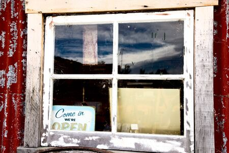 Old Weathered Window with welcome sign New Zealand