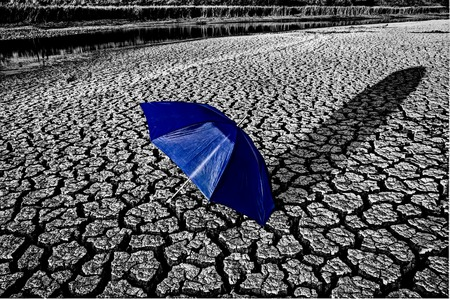 Dry River Bed cracked soil umbrella, Canada Drought