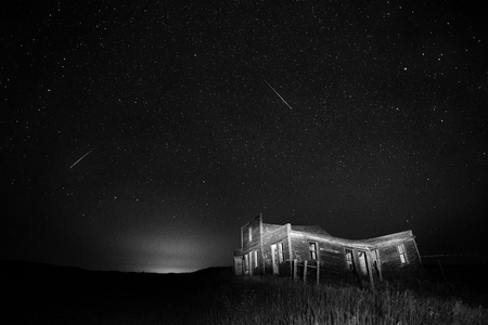 Ghost Town Saskatchewan night shot star trails Stock Photo