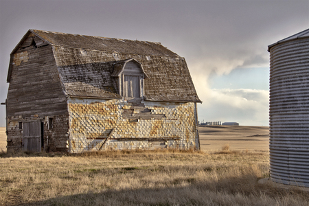 Prairie Storm Clouds rural Saskatchewan Old Barn Stock Photo