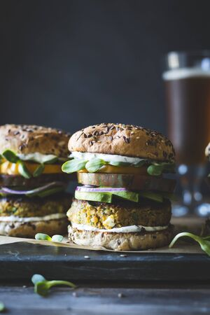 minted: Spiced Zucchini, Feta and Chickpea Veggie Burgers with Minted Yogurt Sauce LANG_EVOIMAGES