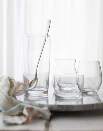 stiring: Empty drinks glasses on a table top with a white background.