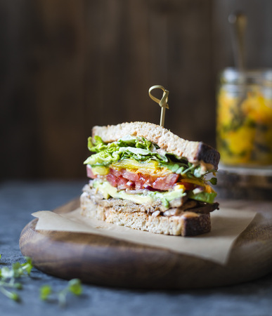 Tempeh bacon, lettuce, tomato sandwich with kimchi, Avocado and Chipotle Mayonnaise