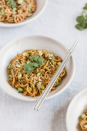 spiralized: A bowl of sweet potato noodle pad thai is photographed from the front view.