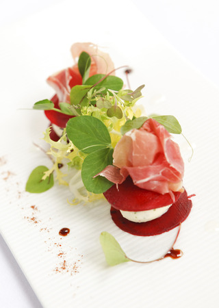 Salad of goats cheese, parma ham and beetroot.