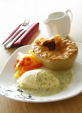 vegtables: Pie, mash and vegtables with a parsley sauce.