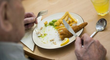 oap: Fish and chips served in an old folks home.