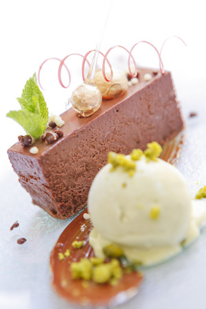 Chocolate marquise with mango coulis and pistachio ice cream.