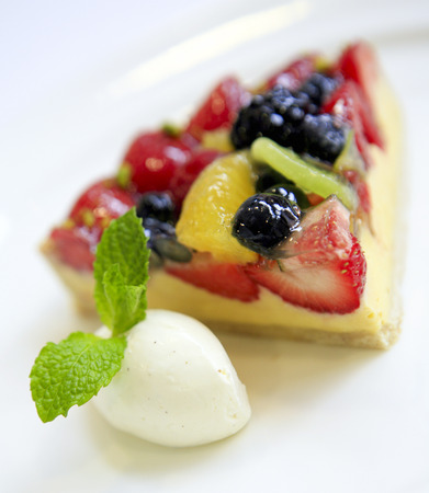 Sweet cakes from a patisserie. Fruit flan with cream.