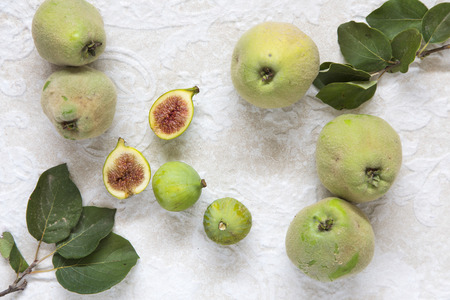 quinces: wild quinces and figs, with quince leaves