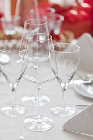 white wine: Wine and water glasses on a white tablecloth