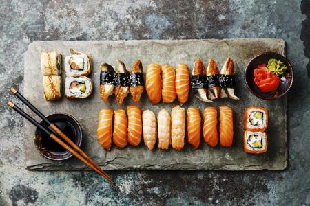 Sushi Set served on gray stone slate on metal background LANG_EVOIMAGES