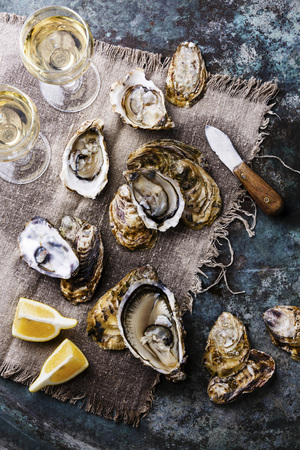 white wine: Open Oysters Fines de Claire with lemon and wine