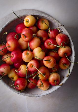 Rainier cherries in a ceramic bowl LANG_EVOIMAGES