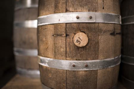 Detail macro shot of a rustic wine barrel.