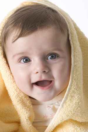 Portrait Of A Happy Baby Girl Wrapped In A Towel photo