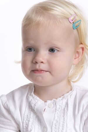 timid: Portrait Of A Blond Toddler Girl With A Timid Expression Stock Photo