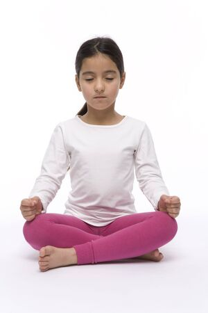 Little Girl Is Sitting In A Yoga Lotus Position Stock Photo - 5434705