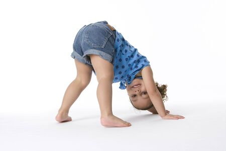 pliable: Little Girl Is Standing On Hands And Feet