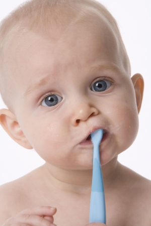 Baby Boy Is Brushing His Teeth With A Toothbrush