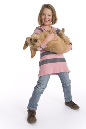 Little Girl Is Carrying Her Pet Dog Full Lenght
