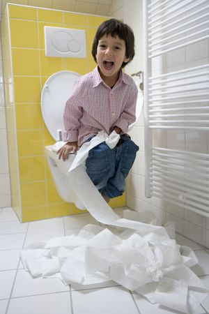 Little Boy Has A Lot Of Fun With Toiletpaper In The Bathroom