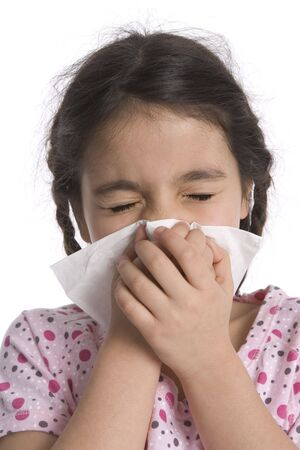 Little girl blows her nose in a paper handkerchief photo