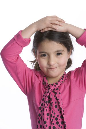 timid: Little Girl Is Looking Into The Camera With A Timid Expression Stock Photo