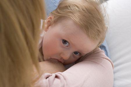 nutricion:  Breastfeeding a baby girl Stock Photo